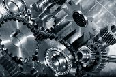 cogwheels and gears in titanium, aerospace engineering parts in a metal toning concept poster