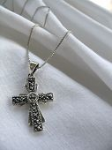 Cross On White Fabric