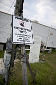 foto of katrina  - Warning sign in yard after Hurricane Katrina - JPG