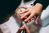 Gel Nail Extensions Build Up Process. Women At Beauty Parlour Doing Manicure. poster