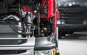 Broken Semi Truck Service Closeup Photo. Truck Maintenance Before Long Heavy Load Trip. poster