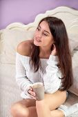 Asian Women Relaxing Home. Morning Girl Asian. Young Asian Woman Relax White Bed Keep Mug Tea And Co poster