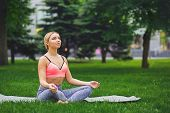 Young Smiling Woman Outdoors, Meditation Exercises. Girl Does Bufferfly Pose For Relaxation. Wellnes poster