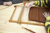stock photo of handloom  - close up of loom tool on a workshop - JPG