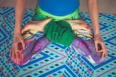 woman legs in colorful leggings in lotus pose from above view indoor shot poster