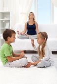 Woman trying to relax with two quarreling child - focus on the boy, motion blur on the girl