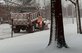 Snow-removing Machine Cleans The Street Of The City Park From The Snow In The Morning Snow-covered T poster