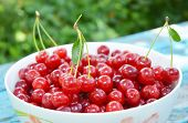 Ripe Cherries. Cherry On Blue Wooden Background. Fresh Cherries In Color Bowl. Red Cherry As Healthy poster