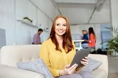 business, education, technology and people concept - smiling young redhead woman with tablet pc comp poster