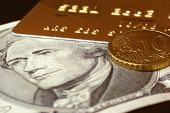 Ten Dollar Note, Gold Credit Card And Ten Euro Cents
