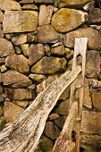 Split Rail Fence By Rock Wall