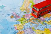 Travelling Abroad By Bus Concept. Red Doubbledecker On The Map, Group Tour To Europe. Tourism And Va poster