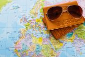 Summer Vacation Planning Background. Preparing Tourist Stuff For A Trip. Passport And Sunglasses On  poster