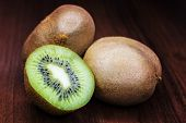 Kiwi On A Wooden Background poster