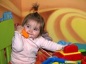 Little Girl  Playing With Toy Phone