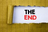 The End. Business Concept For End Finish Close Written On White Paper On Yellow Folded Paper. poster