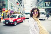 Toothy Smiling Face Happiness Emotion Of Asian Woman Standing On Hongkong City Street poster