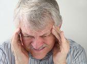 man with terrible headache