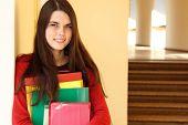 beautiful teen girl in university happy smiling
