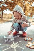 Little Boy 3-5 Years Old, Draws With Colorful Crayons Pavement, Laughs Happy Smiles Rejoices, Summer poster