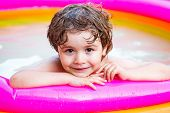 Kids Happy. Child Water Toys. Child Swimming Pool. Little Child Boy Having Fun In The Pool. Kids Lea poster