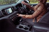 Woman Driving Car, Summer Autumn Forest, Turns Volume On Off Radio, Increases Adjustment Air Conditi poster