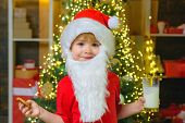 Funny Child Christmas. Santa Claus. Milk And Cookies For Santa Claus. Christmas For Kid. Portrait Of poster
