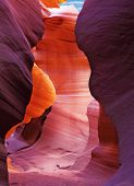 Glowing colorful underground footpath. Famous slot Antelope canyon  in the Navajo reservation. USA.