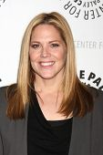 LOS ANGELES - APR 14:  Mary McCormack arrives at the celebration of the final season of USA Network'