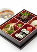 Japanese Meal in a Box (Bento) - Salad, Noodles and Cucumber Sushi Roll, Apple Slice