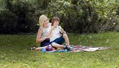 Special Kid Enjoys Amusing Himself With Soap Bubbles On A Park Lawn poster