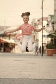 Getting Higher And More Active. Active Little Girl In Motion On Urban Background. Happy Small Child  poster