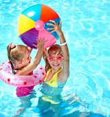 stock photo of pool ball  - Child playing in swimming pool - JPG