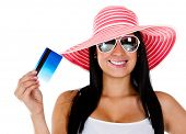 stock photo of save money  - Woman planning her vacations and holding card  - JPG