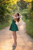 Beautiful Brunette Girl In Glamorous Green Dress And High Heels, Shoes In Nature. Ready For Prom Nig poster