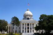 stock photo of alabama  - Alabama State Capitol building and grounds in Montgomery Alabama USA against a blue sky - JPG