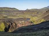 Icelandic Landscape With Blue Markarfljot River Canyon, Green Hills And Einhyrningur Unicorn Mountai poster