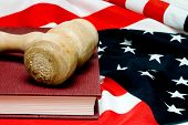 picture of law-books  - An open law book and a judges gavel on an American flag - JPG