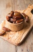 Dates Or Dattes Palm Fruit In Wooden Bowl Is Snack Healthy. Dates In Bowl poster