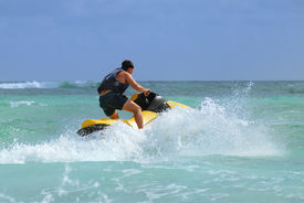 image of waverunner  - Man on Wave Runner turns fast on the water - JPG