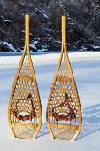 vintage wooden Huron snowshoes with leather binding in snow