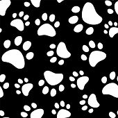 Paw footprints of a dog or a cat seamless pattern in black snd white, vector