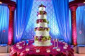 stock photo of indian wedding  - Image of a tall tiered wedding cake at Indian wedding - JPG