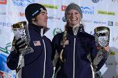 BUKOVEL, UKRAINE - FEBRUARY 23: Kiley McKinnon, USA (right) and Michael Rossi, USA got awards during Freestyle Ski World Cup in Bukovel, Ukraine on February 23, 2013.