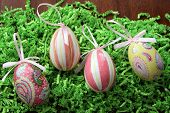 Pretty decorative eggs on shredded grass