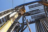 stock photo of oilfield  - Rig station working in drilling operation with man - JPG