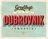 Vintage Touristic Greeting Card - Dubrovnik, Croatia - Vector EPS10. Grunge effects can be easily re