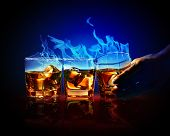 foto of absinthe  - Image of three glasses of burning yellow absinthe - JPG