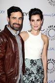 LOS ANGELES - FEB 27:  Jesse Bradford, Carly Pope arrive at the PaleyFest Icon Award 2013 at the Pal