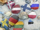 Colorful National Flags Of The Nine Baltic Sea States On Stones On The Beach